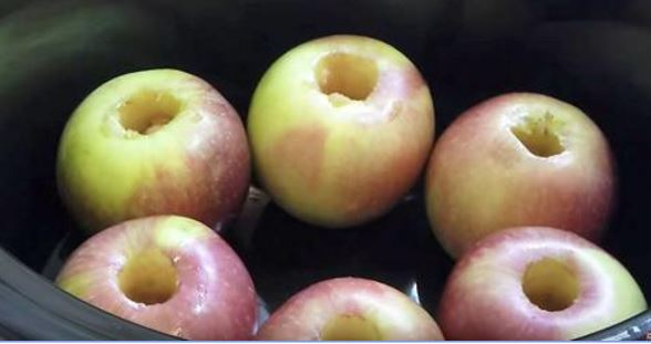 Hollow out apples and put in slow cooker. Recipe's warm sauce on tops makes for the best treat