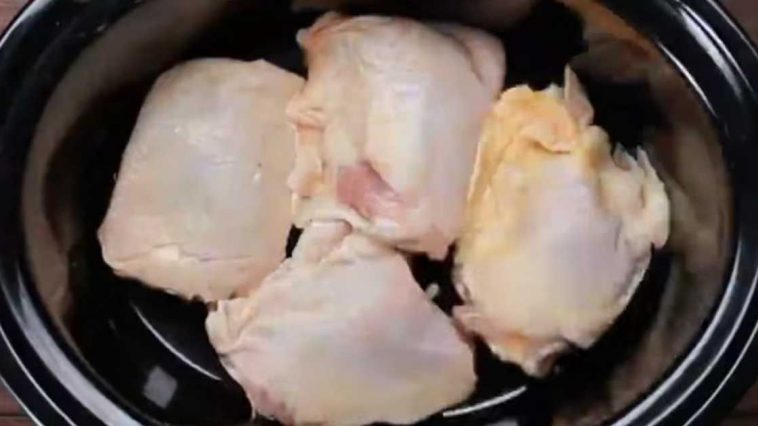 Put chicken in a crock pot, but what goes on top turns it into an irresistible family meal
