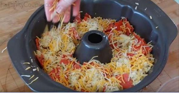 Put cheese and pepperoni into bundt pan. Result is a scrumptious pull-apart pizza breaad